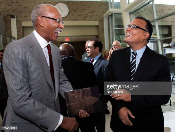 White House Council on Auto Communities and Workers Executive Director Ed Montgomery and Detroit Mayor Dave Bing talk before a press event at Detroit...