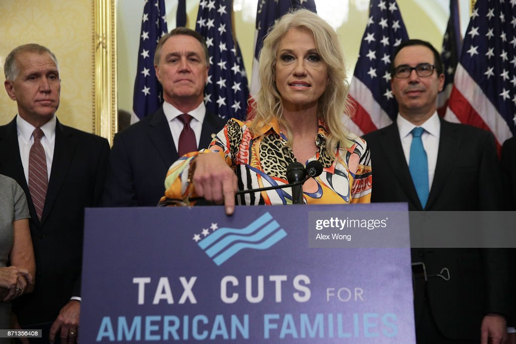 White House Counselor Kellyanne Conway (3rd L) speaks as (L-R) U.S. Sen. Thom Tillis (R-NC), Sen. David Perdue (R-GA) and Secretary of the Treasury Steven Mnuchin listen during a news conference on tax reform November 7, 2017 on Capitol Hill in Washington, DC. Senate Republicans held a news conference to discuss 'the need for tax reform and the impact it will have on American families, small businesses and the economy.'