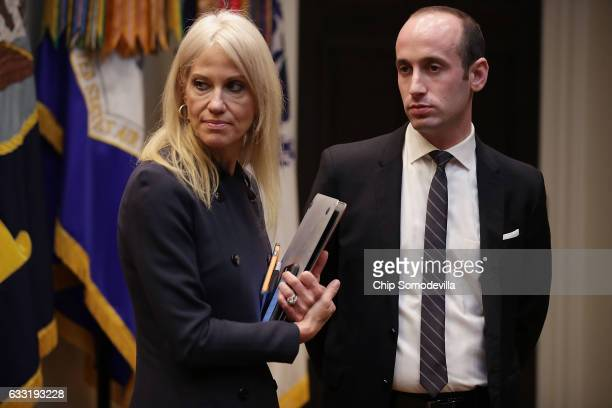 White House Counselor to the President Kellyanne Conway and Senior Advisor for Policy Stephen Miller wait for the arrival of US President Donald...