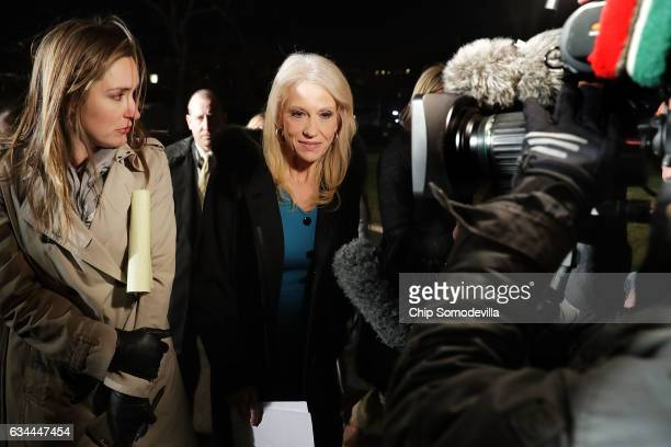 White House Counselor to the President Kellyanne Conway talks with reporters while walking back into the White House following an interview with FOX...