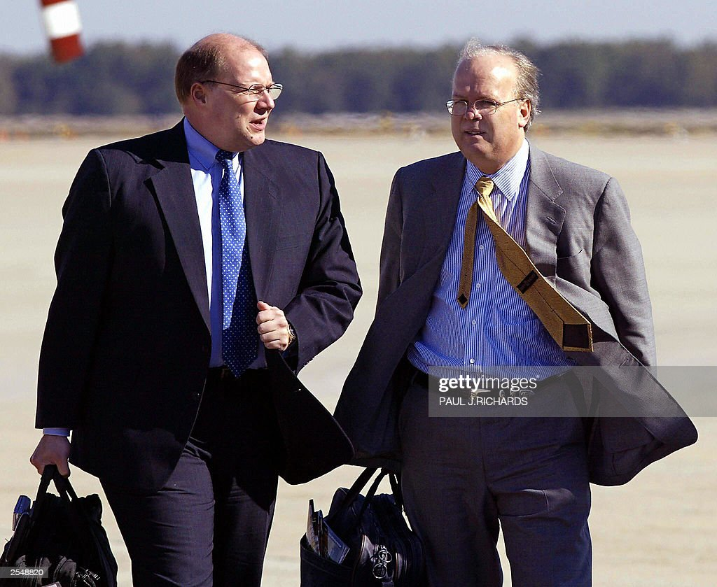 White House Deputy Chief of Staff Joe Hagin (L) and Senior Adviser to US President Goerge W. Bush Karl Rove (R) talk on the tarmac at Andrews Air Force Base, Maryland, as they walk towards Air Force One 30 September, 2003. Bush is on a trip to Chicago and Cincinnati. Rove has been linked by former ambassador Joseph Wilson to the leak identifying his wife as a covert CIA agent. The US Department of Justice has opened a formal investigation into the leak. The White House has called the allegation against Rove 'ridiculous.' AFP Photo/Paul J. RICHARDS