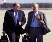 White House Deputy Chief of Staff Joe Hagin and Senior Adviser to US President Goerge W Bush Karl Rove talk on the tarmac at Andrews Air Force Base...