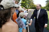 White House Deputy Chief of Staff Joe Hagin shakes hands with White House staff and their families after he returned to the White House from Crawford...