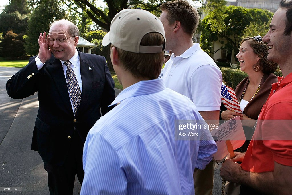 White House Deputy Chief of Staff Joe Hagin touches his face as he bids farewell to White House staff and their families after he returned to the...