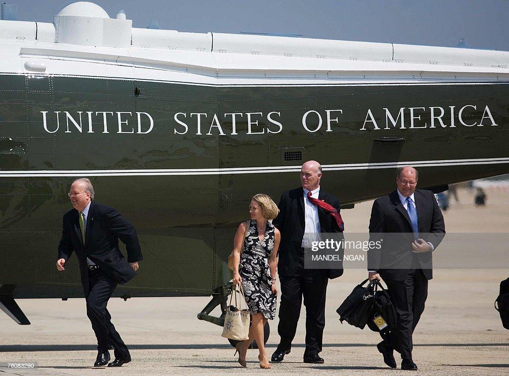 White House Deputy Chief of Staff Karl Rove runs towards US President George W Bush beside Deputy Press Secretary Dana Perino and White House Deputy...