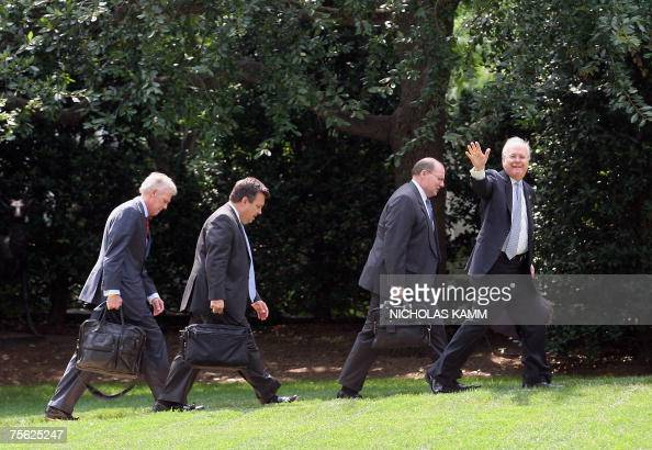 White House Deputy Chief of Staff Karl Rove waves to the press as he walks towards the Oval Office at the White House with top aides from Press...