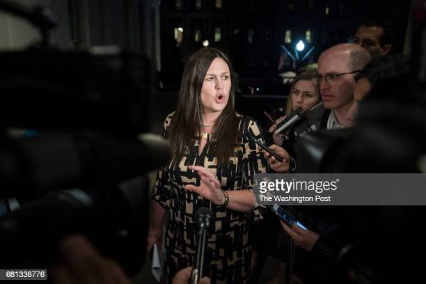 White House deputy press secretary Sarah Huckabee Sanders speaks to reporters outside the West Wing after President Donald J Trump terminated FBI...