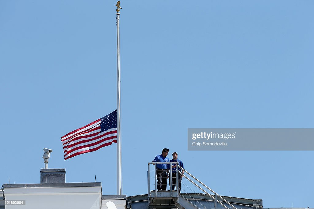 White House employees walk down from the rooftop after lowering the national flag to half-staff September 12, 2012 in Washington, DC. The flag was lowered for U.S. ambassador to Libya J. Christopher Stevens and three other embassy employees who were killed when the embassy in Benghazi was attacked by a mob potentially angered by an American-made video mocking Islam's founding prophet.