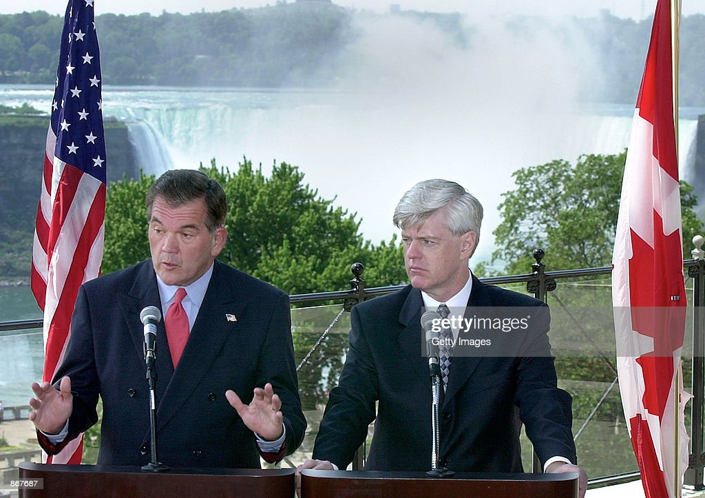 White House Homeland Security Advisor Tom Ridge and Canadian Deputy Prime Minister John Manley address the news media from a vantage point...
