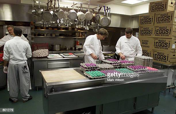 White House kitchen chef assistants prepare eggs for the annual White House Easter Egg Roll April 13 2001 in Washington DC The event will be held on...