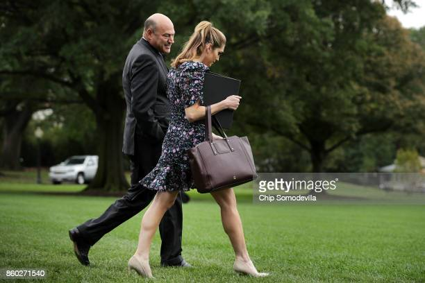 White House National Economic Council Director Gary Cohn and Strategic Communications Director Hope Hicks leave the White House October 11 2017 in...