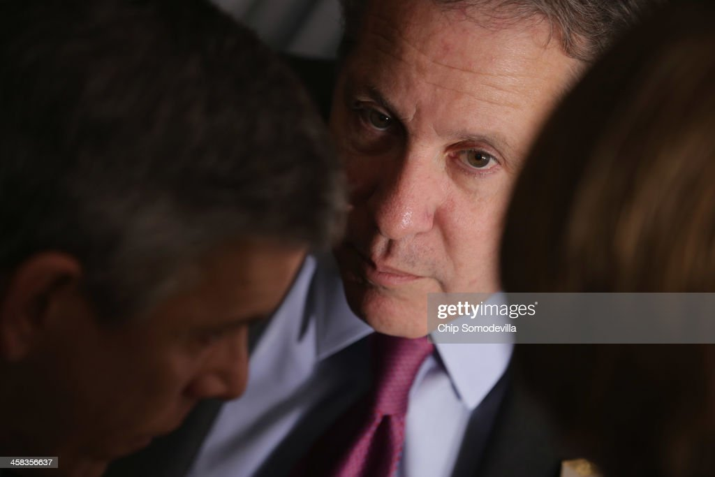 White House National Economic Council Director Gene Sperling (C) talks with Education Secretary <a gi-track='captionPersonalityLinkClicked' href=/galleries/search?phrase=Arne+Duncan&family=editorial&specificpeople=3049193 ng-click='$event.stopPropagation()'>Arne Duncan</a> and others before U.S. President Barack Obama delivers remarks about the ConnectED program at Buck Lodge Middle School February 4, 2014 in Adelphi, Maryland. As part of the president's ConnectED program, Obama has tasked the Federal Communications Commission to help to build high-speed digital connections to America's schools and libraries, with the goal of getting 99-percent of American students to next-generation broadband and wireless technology within five years.