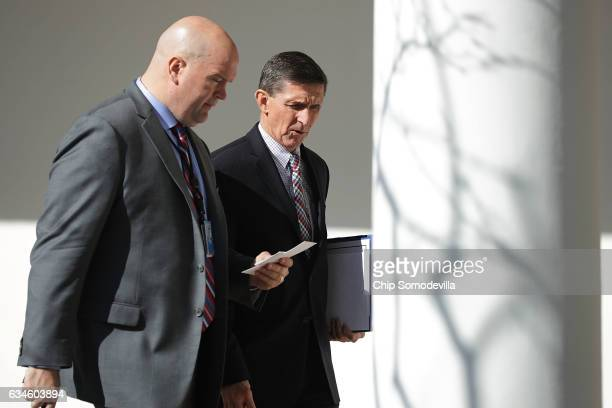 White House National Security Advisor Michael Flynn walks down the West Wing Colonnade following a bilateral meeting between US President Donald...