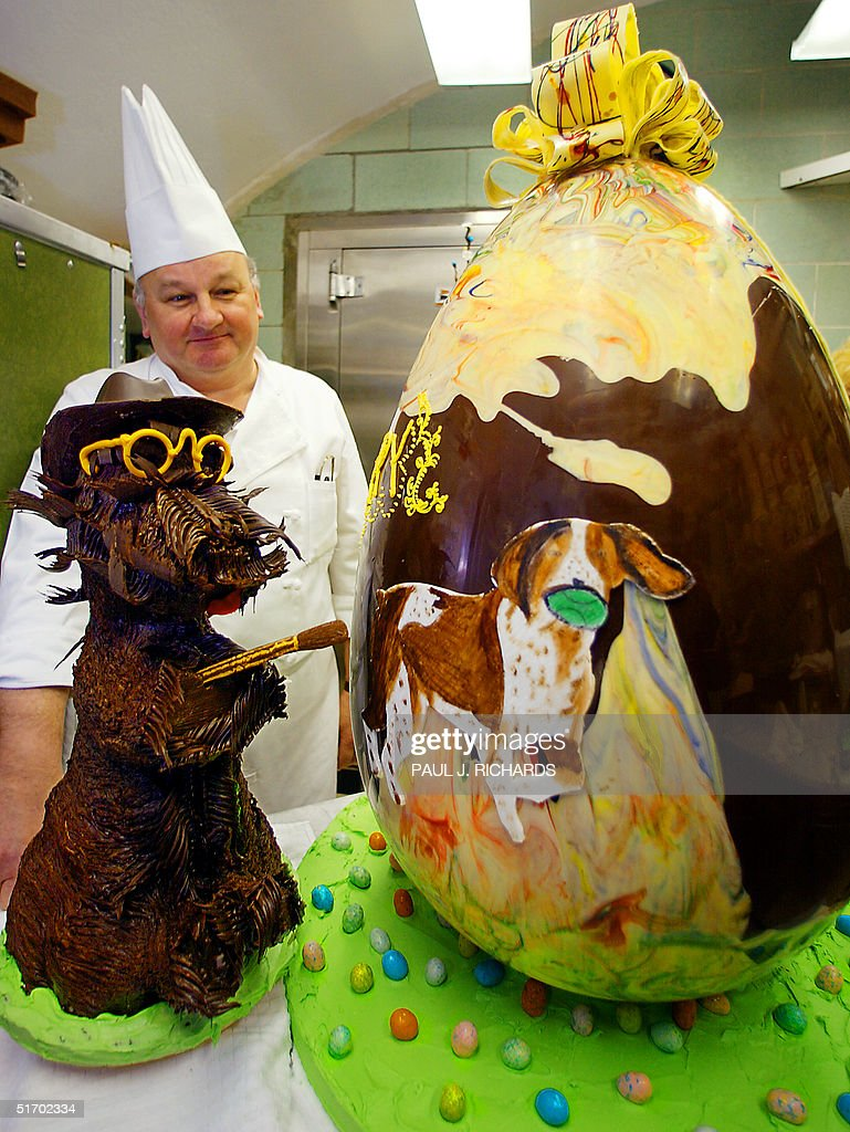 White House Pastry Chef Roland Mesnier looks over his 40lb 41/2 foot tall semisweet chocolate Easter Egg in the kitchen of the White House 29 March...