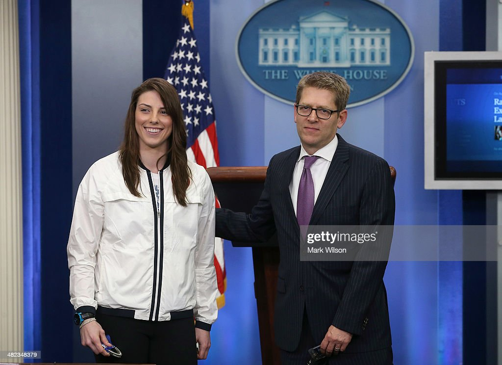 White House Press Secretary <a gi-track='captionPersonalityLinkClicked' href=/galleries/search?phrase=Jay+Carney&family=editorial&specificpeople=1064957 ng-click='$event.stopPropagation()'>Jay Carney</a> (R) gives his cousin, U.S. Women's Olympic Hockey player Hilary Knight, a tour of the Brady Briefing Room at the White House on April 3, 3014 in Washington, DC. Today President Barack Obama and first lady Michelle Obama welcomed and congratulated U.S. Olympians and Paralympians on their performance and thanked them for representing the United States during the 2014 Olympic Winter Games in Sochi, Russia.