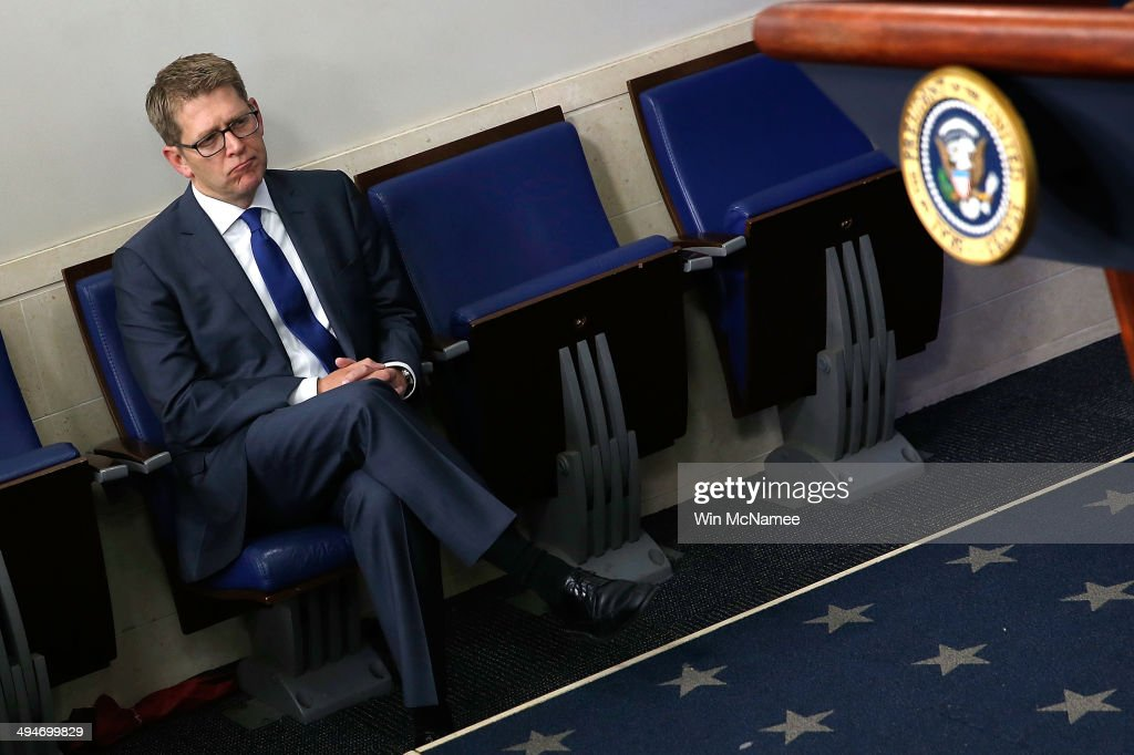 White House Press Secretary Jay Carney watches as U.S. President Barack Obama announces the resignation of Secretary of Veterans Affairs Eric Shinseki May 30, 2014 in Washington, DC. Carney announced today that he is resigning effective in mid-June and will be replaced by Deputy Press Secretary Josh Earnest.
