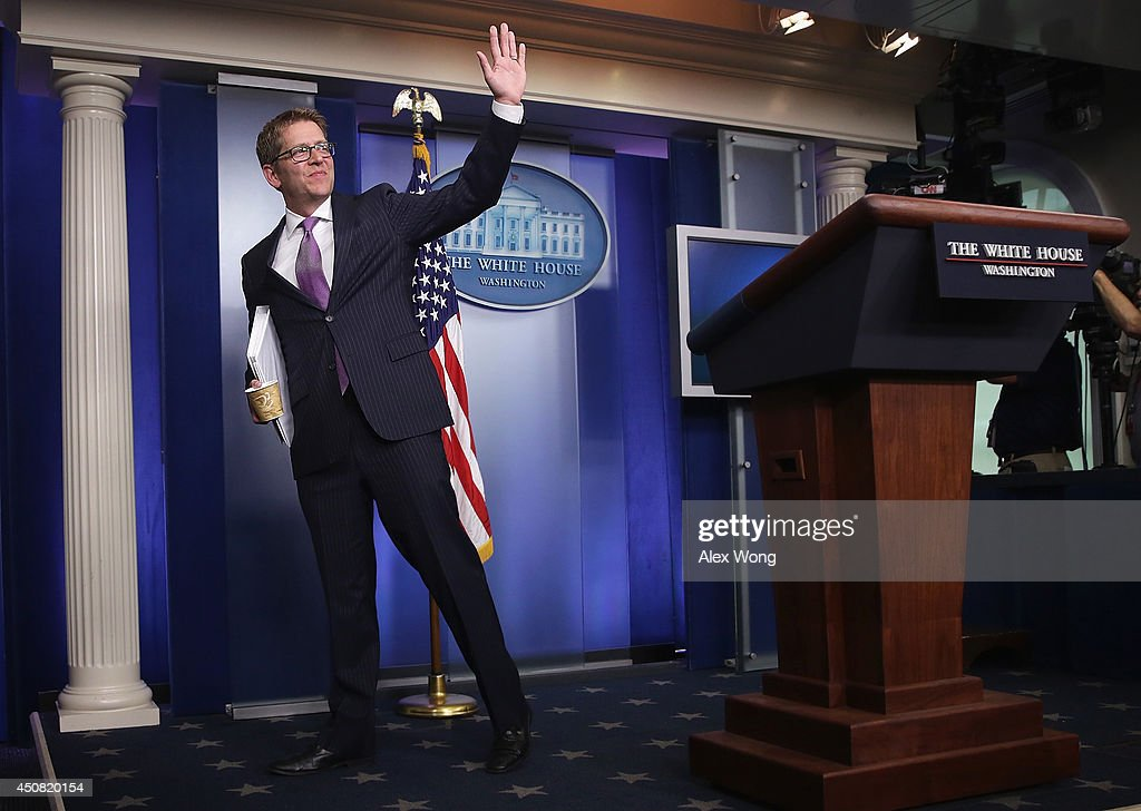 White House Press Secretary Jay Carney waves at the end of his last White House briefing at the James Brady Press Briefing Room of the White House June 18, 2014 in Washington, DC. Jay Carney was stepping down from his position as the White House Press Secretary.