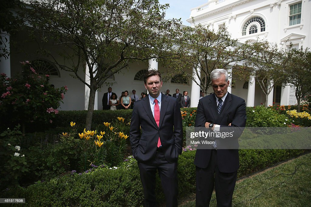 White House Press Secretary <a gi-track='captionPersonalityLinkClicked' href=/galleries/search?phrase=Josh+Earnest&family=editorial&specificpeople=6990565 ng-click='$event.stopPropagation()'>Josh Earnest</a> (L) and White House Chief of Staff <a gi-track='captionPersonalityLinkClicked' href=/galleries/search?phrase=Denis+McDonough&family=editorial&specificpeople=5759820 ng-click='$event.stopPropagation()'>Denis McDonough</a> (R) listen to U.S. President Barack Obama speak about immigration reform in the Rose Garden of the White House June 30, 2014 in Washington, DC. Speaker of the House John Boehner (R-OH) said today that the House of Representatives would not take up immigration reform legislation this year and Obama said he would continue to use his executive power to bolster enforcement on the southern border.