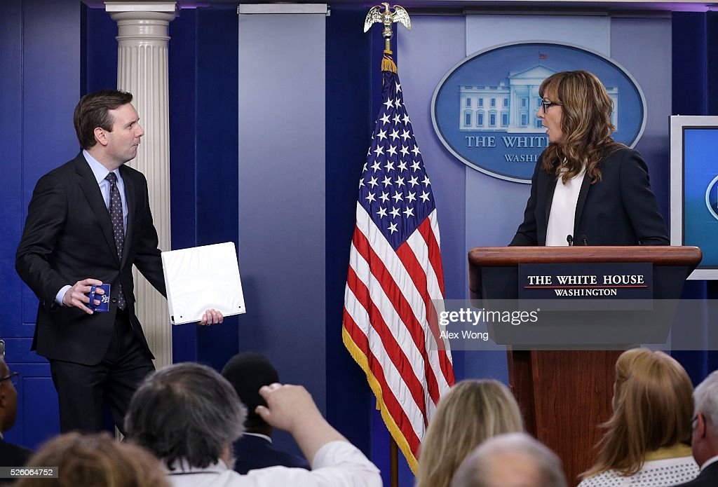 White House press secretary <a gi-track='captionPersonalityLinkClicked' href=/galleries/search?phrase=Josh+Earnest&family=editorial&specificpeople=6990565 ng-click='$event.stopPropagation()'>Josh Earnest</a> (L) comes in with a mock surprise as actress <a gi-track='captionPersonalityLinkClicked' href=/galleries/search?phrase=Allison+Janney&family=editorial&specificpeople=206290 ng-click='$event.stopPropagation()'>Allison Janney</a> (R) speaks as she shows up to surprise members of the press crops at the James Brady Press Briefing Room April 29, 2016 in Washington, DC. Janney, who was known to viewers as White House press secretary C.J. Cregg in the drama series The West Wing, was in town to call for attention on the opioid epidemic.
