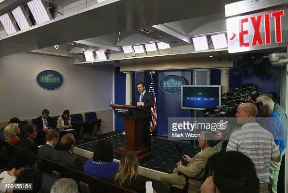 White House Press Secretary Josh Earnest resumes his press briefing following a brief evacuation of the Press Briefing Room at the White House June 9...