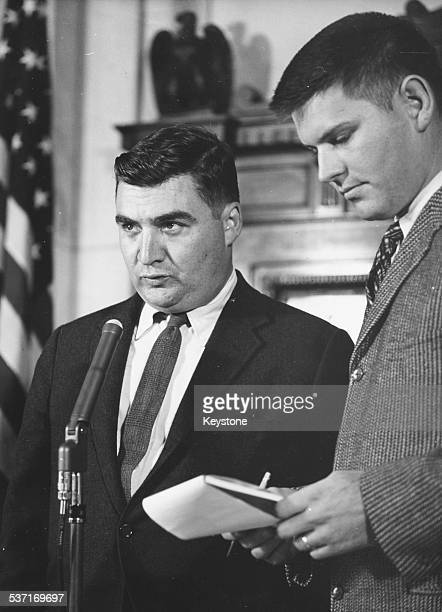 White House Press Secretary Pierre Salinger giving a speech at a press conference following the victory of President Kennedy in the election at the...