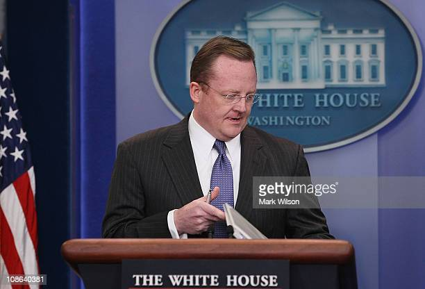 White House Press Secretary Robert Gibbs walks up to the podium during a press briefing at the White House on January 31 2011 in Washington DC...