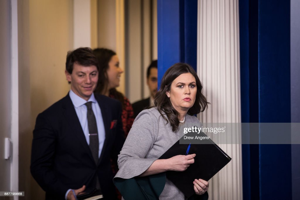 White House press secretary Sarah Huckabee Sanders arrives for the daily briefing at the White House, December 7, 2017 in Washington, DC.