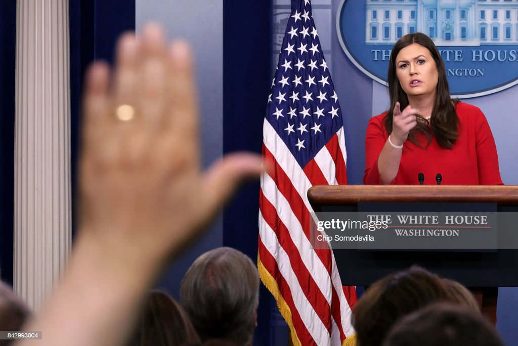 White House Press Secretary Sarah Huckabee Sanders calls on reporters during the daily news conference in the Brady Press Briefing Room at the White House September 5, 2017 in Washington, DC. Sanders fielded questions about President Donald Trump's decision to end the Deferred Action for Childhood Arrivals immigration policy, an Obama-era executive action that allows certain undocumented immigratns who entered the country as minors to receive a renewable two-year period of deferred action from deportation and eligibility for a work permit.