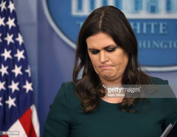 White House Press Secretary Sarah Huckabee Sanders looks at her notes during her daily press briefing at the White House on October 20 2017 in...