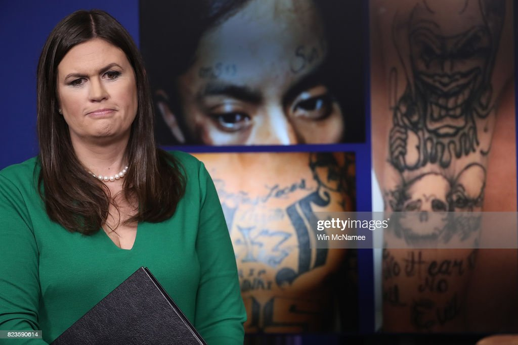 White House Press Secretary Sarah Huckabee Sanders stands in front of gang related photos from the MS-13 gang during a daily briefing at the White House July 27, 2017 in Washington, DC. Sanders answered a range of questions during the briefing.