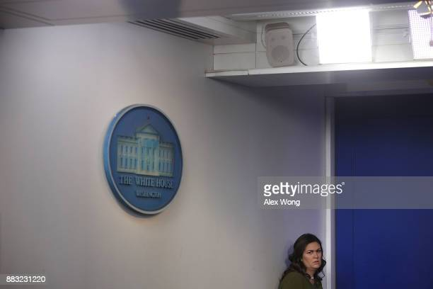White House Press Secretary Sarah Huckabee Sanders waits for her turn to speak during a daily news briefing at the James Brady Press Briefing Room of...