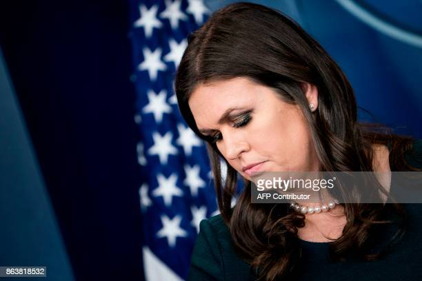 White House Press Secretary Sarah Sanders pauses during a briefing at the White House October 20 2017 in Washington DC / AFP PHOTO / Brendan...