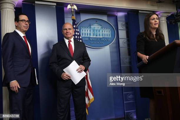 White House Press Secretary Sarah Sanders speaks as US Treasury Secretary Steven Mnuchin and National Security Adviser HR McMaster look on during a...