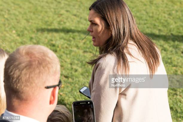 White House Press Secretary Sarah Sanders speaks to reporters as they await the departure of President Donald Trump and family from the South Lawn of...