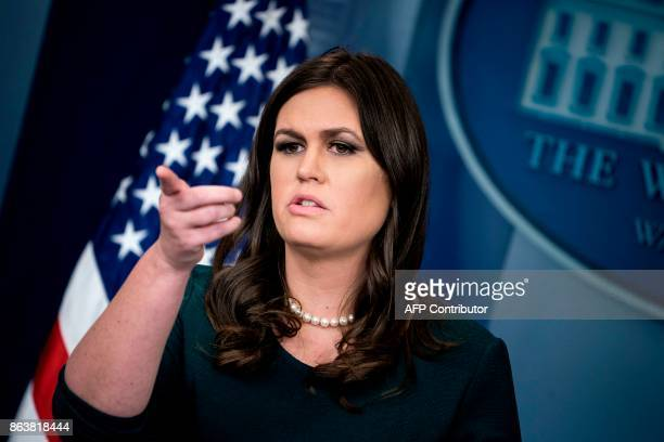 White House Press Secretary Sarah Sanders takes a question during a briefing at the White House October 20 2017 in Washington DC / AFP PHOTO /...