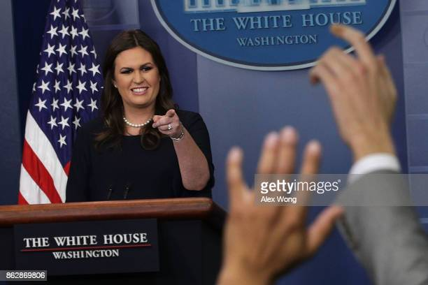 White House Press Secretary Sarah Sanders takes questions during a daily briefing at the James Brady Press Briefing Room of the White House October...