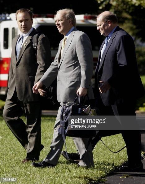 White House Press Secretary Scott McCelland walks with advisor Karl Rove and Deputy Chief of Staff Joe Hagin as they follow US President George W...