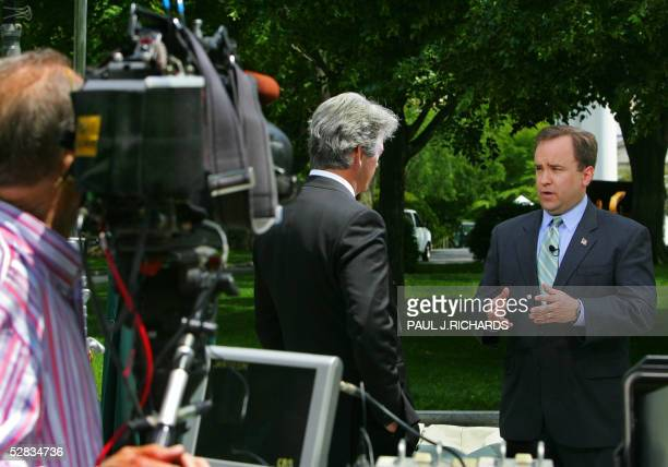 White House Press Secretary Scott McClellan conducts an interview on the front lawn of the White House with CBS's John Roberts after doing the same...