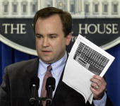 White House Press Secretary Scott McClellan holds recently found documents that he says prove that US president George W Bush did serve for the Texas...