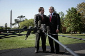 White House Press Secretary Scott McClellan left talks with President George W Bush on the South Lawn of the White House as McClellan announces he...