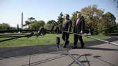 White House Press Secretary Scott McClellan left walks to with President George W Bush on the South Lawn of the White House as McClellan announces he...