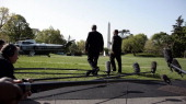 White House Press Secretary Scott McClellan right walks to Marine One with President George W Bush on the South Lawn of the White House after...