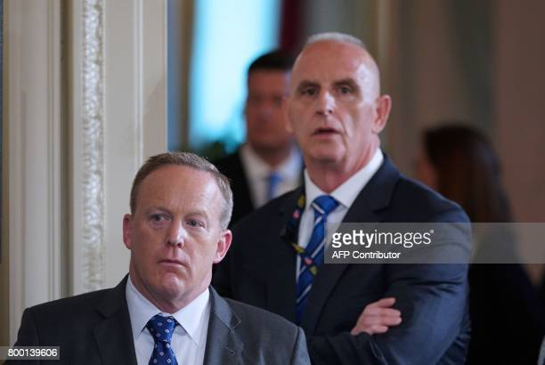 White House Press Secretary Sean Spicer and Director of Oval Office operations Keith Schiller attend the signing ceremony for the Department of...