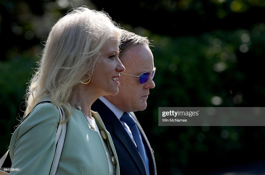 White House press secretary Sean Spicer (R) and Kellyanne Conway (L), counsel to the President, board a waiting Marine One presidential helicopter while U.S. President Donald Trump departs the White House May 17, 2017 in Washington, DC. Trump is scheduled to deliver a commencement address later today at the U.S. Coast Guard Academy in Connecticut.