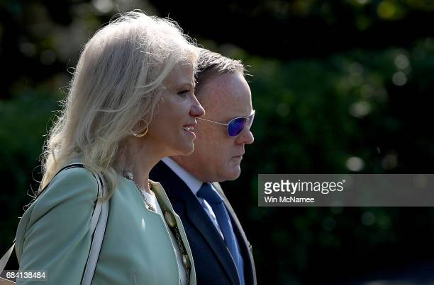 White House press secretary Sean Spicer and Kellyanne Conway counsel to the President board a waiting Marine One presidential helicopter while US...