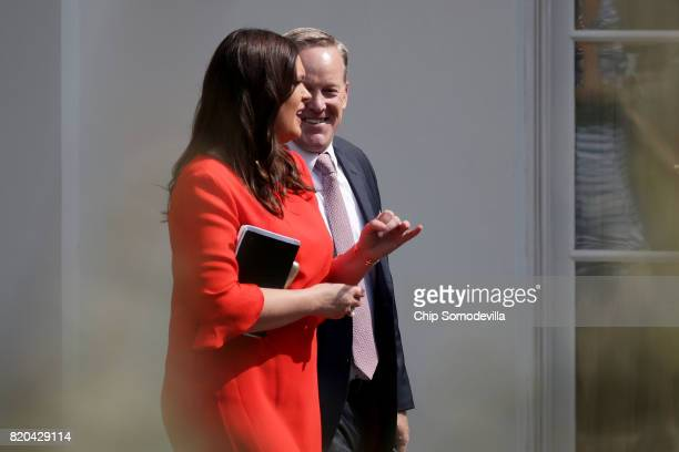 White House Press Secretary Sean Spicer and Principal Deputy Press Secretary Sarah Huckabee Sanders walk out of the White House July 21 2017 in...
