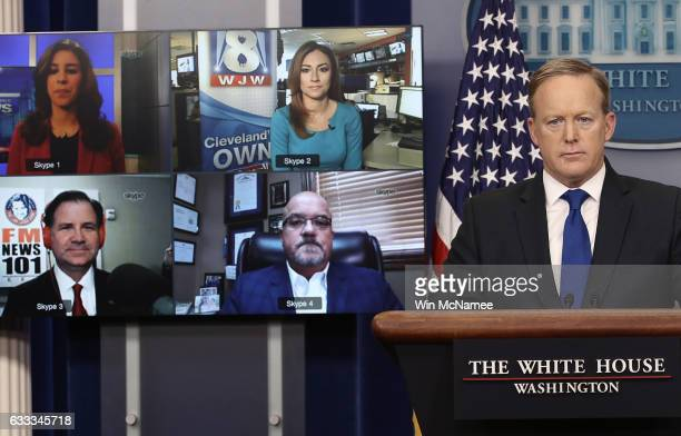 White House Press Secretary Sean Spicer answers questions from reporters via Skype on February 1 2017 in Washington DC The 'Skype Seats' in the...