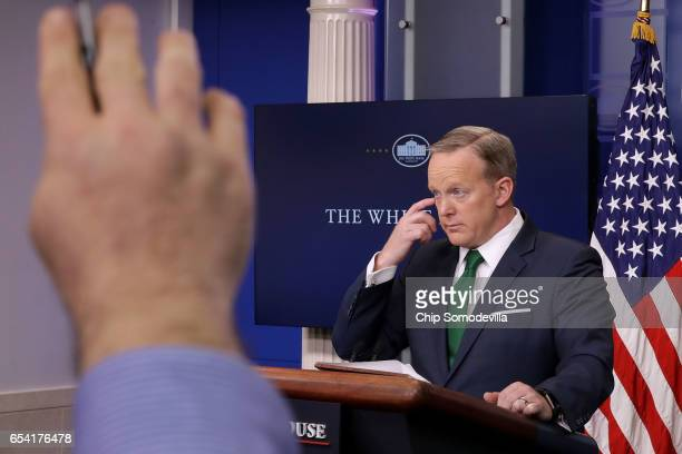 White House Press Secretary Sean Spicer answers reporters' questions in the Brady Press Briefing Room at the White House March 16 2017 in Washington...