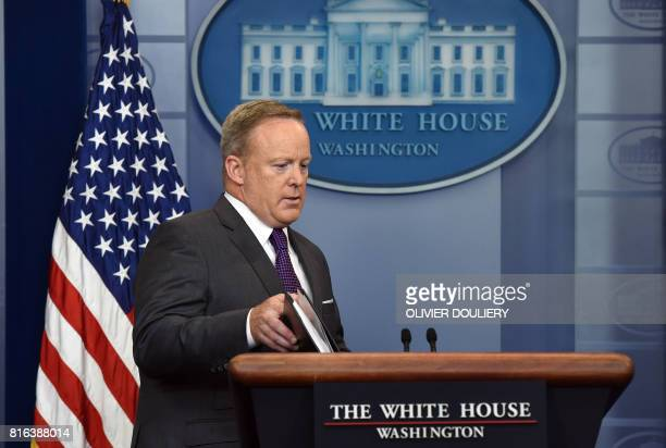 White House Press Secretary Sean Spicer arrives to brief members of the media during a daily briefing at the White House July 17 2017 in Washington...