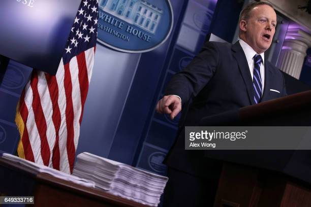 S White House Press Secretary Sean Spicer compares as he points to a copy of the Obamacare Bill and a copy of the new House Republican Healthcare...